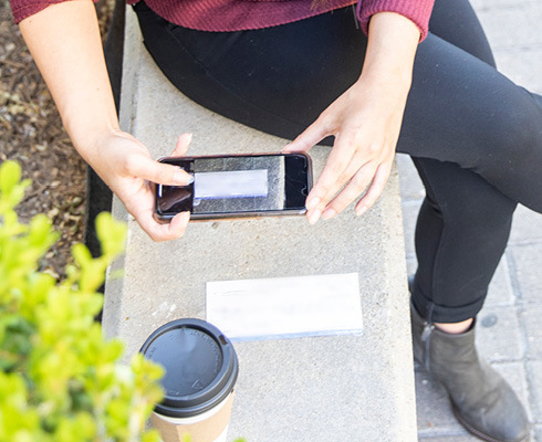 Woman depositing a check from her smartphone